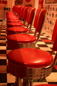 Red stools at the counter