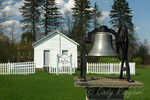 One room schoolhouse and bell