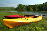 Kayaks beside the pond