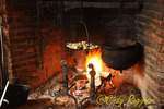 Cooking in an open hearth