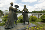 The Anthony-Stanton-Bloomer statue stands on parkland overlooking the Seneca River in downtown Seneca Falls. At left, Susan B. Anthony; center, dress reformer Amelia Bloomer; right, Elizabeth Cady Stanton.