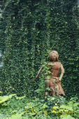 Metal sculpture among climbing ivy