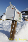 Mailbox, icicle, and snow
