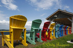 Colorful Adirondack chairs sit beside the river, Clayton NY, Thousand Island region