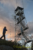 Photographers at sunset at Belfry Mountain fire tower, Adirondack region, New York state