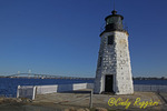 The Newport Harbor Lighthouse, also known as Goat Island Light, with the Claiborne Pell Bridge, commonly known as the Newport Bridge, in the background, Newport RI