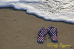 Flip flops by the waves