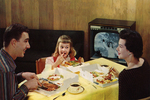 Family Enjoys TV Dinner