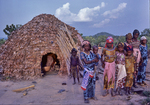 Fulani nomads, children beside hut