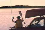 boy excited about canoeing and fishing