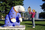 teenager photographing bear statue