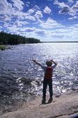 hiker along Nutimik Lake, Whiteshell Provincial Park, Manitoba, Canada