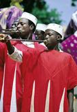men playing traditional horns during Ramadan Festival, Bida, Nigeria, West Africa