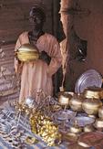 man selling metalware, Bida, Niger State, Nigeria, West Africa
