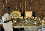 boy selling metalware, Bida, Nigeria, West Africa
