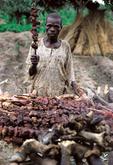 man selling meat, Minna, nigeria, West Africa