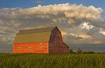 barn and collasping cumulonimbus cloud mass near Bromhead, Saskatchewan, Canada