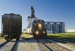 a locomotive picks up rail  hopper cars at an inland grain terminal, near Winnipeg, Manitoba