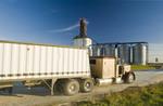 a truck hauling soybeans to an inland terminal  , near Winnipeg, Manitoba, Canada