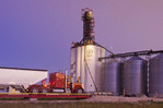 a truck hauling soybeans to an inland terminal  , near Winnipeg, Manitoba, Canada
