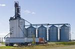 a truck hauling soybeans to an inland terminal waits while a moisure probe checks the crop , near Winnipeg, Manitoba, Canada