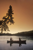 couple canoeing , Duck Mountain Provincial Park, Manitoba, Canada