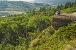 hiker at the Conglomerate Cliffs lookout,Cypress Hills Interprovincial Park, Saskatchewan, Canada