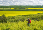 a hiker looks out over the Qu´Appelle  River Valley,  Saskatchewan, Canada