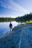 hiker along the Grass River, Pisew Falls Provincial Park, Manitoba, Canada
