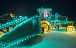 swather with Christmas lights, Manitoba, Canada