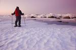 man snowshoeing, Lake Winnipeg, Manitoba, Canada