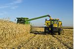 a combine unloads grain corn into a grain wagon during the harvest, near La Salle, Manitoba, Canada