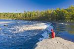 hiker, autumn, Rainbow Falls along the Whiteshell River, Whiteshell Provincial Park, Manitoba, Canada