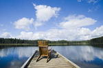 chair on dock, Two Mile Lake , Duck Mountain Provincial Park, Manitoba, Canada