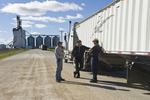 farmers next to a farm truck hauling crop to an inland terminal