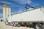 A moisture probe tests a load of oats in the back of a farm truck at an inland grain terminal,