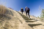 couple hiking in the Spirit Sands, Spruce Woods Provincial Park, Manitoba, Canada