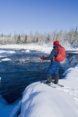 snowshoeing, winter along the Whiteshell River at Rainbow Falls, Whiteshell Provincial Park, Manitoba, Canada