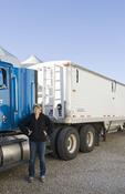 female farmer next to farm truck, Dugald, Manitoba, Canada