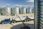 a super B grain truck being loaded with barley from grain storage bins near St. Jean,  Manitoba, Canada