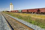 rail hopper cars wait on a siding next to an inland grain terminal, Rosser, Manitoba, Canada