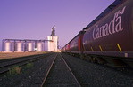 inland grain terminal with rail hopper cars in the foreground, Morris, Manitoba, Canada