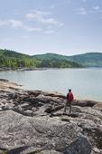 hiker along shoreline, Neys Provincial Park, Lake Superior,  Ontario, Canada
