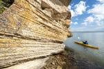 kayaking near  cliffs, near Pine Dock, along Lake Winnipeg, Canada