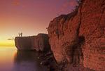 hikers on limestone cliff, Steep Rock, along Lake Manitoba, Canada