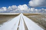 gravel road covered with snow, near Hazenmore, Saskatchewan, Canada