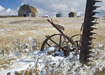 old barn with sickle bar hay mower in the foreground near Hazenmore, Saskatchewan, Canada
