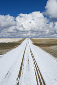 gravel road covered with snow, near Hazenmore, Saskatchewan, Canada