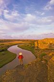 hiker along the Milk River, Writing On Stone Provincial Park, Alberta, Canada