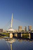 Winnipeg skyline showing close-up of the Esplanade Riel foot bridge, from St. Boniface,  Manitoba, Canada